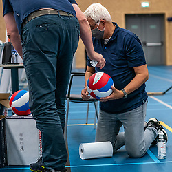 A Covid-19 rule is that all balls are disinfected to each set.<br />  during the supercup final between Amysoft Lycurgus - Active Living Orion on October 04, 2020 in Van der Knaaphal, Ede