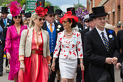 Ascot, UK. 20 June, 2019. Racegoers wearing morning dress and fancy hats attend Ladies Day at Royal Ascot.