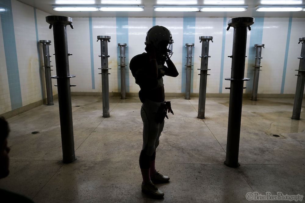 Rio Americano Raiders Noah Metz (2), gets ready inside the lshower area of the ocker room before the game as the El Camino Eagles host the Rio Americano Raiders at Del Campo High School, Friday Oct 7, 2016. <br /> photo by Brian Baer