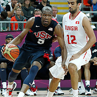 31 July 2012: USA Kevin Durant drives past Tunisia Makram Ben Romdhane during 110-63 Team USA victory over Team Tunisia, during the men's basketball preliminary, at the Basketball Arena, in London, Great Britain.