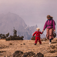 Meredith Wiltse and her 3-year old son Ben scamper down a mountain hillside while trekking in the Khumbu region of Nepal.
