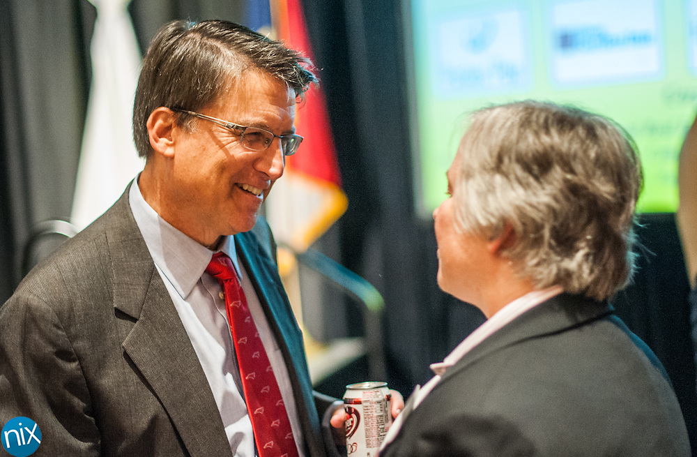Governor Pat McCrory speaks with Cabarrus County commissioner Liz Poole during a State of the Region Summit hosted by the Cabarrus Regional Chamber of Commerce Thursday morning at Embassy Suites in Concord.