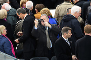 Senator Dick Durbin takes a photo as he waits for the start of the President Inaugural Ceremony on Capitol Hill January 20, 2017 in Washington, DC. Donald Trump became the 45th President of the United States in the ceremony.