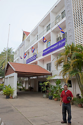 Titony Dith In Front Of Former US Embassy Building
