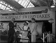 22/10/1959<br /> 10/22/1959<br /> 22 October 1959<br /> Irish Hospitals Trust 97th Sweepstake Draw on Cambridgeshire 1959 at Irish Hospital Sweepstakes office, Ballsbridge, Dublin. Garda Superintendent receives name of horse from special draw.