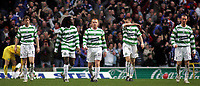 Photo: Paul Thomas.<br /> Glasgow Celtic v Glasgow Rangers. Bank of Scotland Scottish Premier League. 11/03/2007.<br /> <br /> Dejected captain Neil Lennon (18) and Celtic walk back to half way after Rangers score.