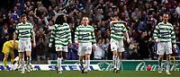 Photo: Paul Thomas.<br /> Glasgow Celtic v Glasgow Rangers. Bank of Scotland Scottish Premier League. 11/03/2007.<br /> <br /> Dejected captain Neil Lennon (18) and Celtic walk back to half way after Rangers score.