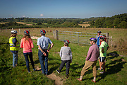 A group of cyclists take a break from their cycling to admire the green countryside view in Staplehurst, Kent, England, UK.  (photo by Andrew Aitchison / In pictures via Getty Images)