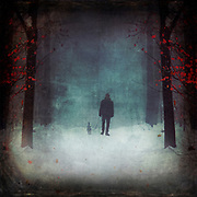 Man walking a dog on a misty winter day - manipulated and textured photograph