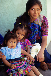 Guatemala, Antigua. Mayan woman and her daughters.