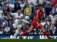 Photo. Glyn Thomas.<br /> Digitalsport<br /> NORWAY ONLY<br /> <br /> Leeds United v Charlton Athletic. <br /> FA Barclaycard Premiership. 08/05/2004.<br /> Leeds' Alan Smith (L) sends in a shot on goal past Charlton's Hermann Hreidarsson.