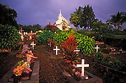 Evening light on the cemetery at St. Benedict's Painted Church, Kona Coast, The Big Island, Hawaii