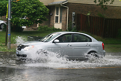 August 2, 2017 - Toronto, Ontario, Canada - Drivers navigate along a flooded road in Toronto, Ontario, Canada, on August 2, 2017. Heavy rain and thunderstorms caused severe flooding in many parts of the city. (Credit Image: © Creative Touch Imaging Ltd/NurPhoto via ZUMA Press)