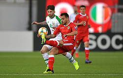 Republic of Ireland's Sean Maguire (left) and Gibraltar's Joseph Chipolina (right) battle for the ball during the UEFA Euro 2020 Qualifying, Group D match at the Victoria Stadium, Gibraltar.