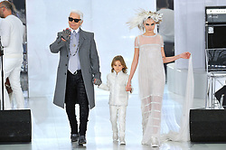 Designer Karl Lagerfeld, his godson Hudson Kroenig and Model Cara Delevingne walk at the end of Chanel Spring-Summer 2014 Haute-Couture collection show held at the Grand Palais, in Paris, France on January 21, 2014. Photo by Thierry Orban/ABACAPRESS.COM