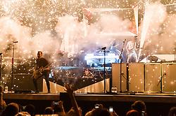 © Licensed to London News Pictures. 24/04/2014. London, UK.   McBusted performing live at The O2 Arena.   In this picture - Danny Jones (left), Matt Willis (centre), and James Bourne (right) who enter the stage at the beginning of the concert by flying down in Delorean car in a spoof of Back To The Future, at which point fireworks burst from the stage.. *** LICENSE CONDITIONS USAGE ALLOWED ONLY UNTIL 14 MAY 2014, NO USAGE BEYOND THAT DATE***.   McBusted are an English pop-rock group composed of members of the bands Busted & McFly - James Bourne, Tony Fletcher, Danny Jones, Harry Judd, Dougie Poynter, and Matt Willis.  The only member of the original groups not participating in the new lineup is former Busted singer CharlieSimpson. Photo credit : Richard Isaac/LNP