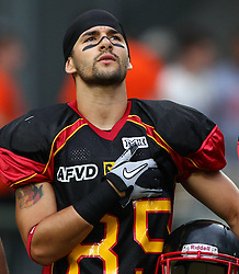 10.07.2011, Tivoli Stadion, Innsbruck, AUT, American Football WM 2011, Group A, Germany (GER) vs United States of America (USA), im Bild Dominic Hanselmann (Germany, #85, WR) during the national anthem // during the American Football World Championship 2011 Group A game, Germany vs USA, at Tivoli Stadion, Innsbruck, 2011-07-10, EXPA Pictures © 2011, PhotoCredit: EXPA/ T. Haumer