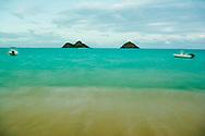 Long exposure photograph as dusk falls on Lanikai Beach, Kailua, Oahu, Hawaii