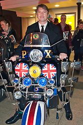 © Licensed to London News Pictures. 04/03/2014. Brynmawr, Blaenau, Gwent.  Jonny Owen tries out one of the motor scooters which have arrived for the premiere. Merthyr Tydfil's very own Jonny Owen premieres his latest film SVENGALI, co-starring Vicky McClure, which was shot on location in the Welsh mining valleys. The premiere is held at the oldest independent cinema in Wales – The Market Hall Cinema in Brynmawr. Photo credit : Graham M. Lawrence/LNP