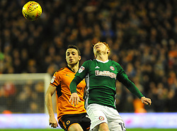 Ryan Woods of Brentford and Diogo Jota of Wolverhampton Wanderers compete for the highball- Mandatory by-line: Nizaam Jones/JMP - 02/01/2018 - FOOTBALL - Molineux - Wolverhampton, England- Wolverhampton Wanderers v Brentford -Sky Bet Championship