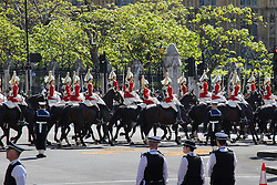 London, May 27th 2015. The Household Cavalry escorts Her Majesty Queen Elizabeth II as she arrives in her carriage at the opening of the Tory majority-led Parliament.