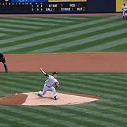 Masahiro Tanaka, New York Yankees, pitching as team mate Ichiro Suzuki, (right), watches from right field during the New York Yankees V Tampa Bay Rays, Major League Baseball game at Yankee Stadium, The Bronx, New York. 3rd May 2014. Photo Tim Clayton