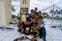 Indonesia, Sumatra. Medan. Kids doing acrobatics on a street in Medan center.