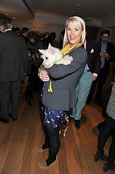 CHARLOTTE SPEEDY and her dog Sky at the launch of George's Dinner for Dogs menu in aid of The Dog's Trust held at George, 87-88 Mount Street, London on 19th March 2013.