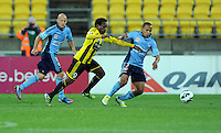 Sydney FC's Fabio, right, contests the ball with Wellington Phoenix's Benjamin Totori in the A-League football match at Westpac Stadium, Wellington, New Zealand, Saturday, October 06, 2012. Credit:SNPA / Ross Setford