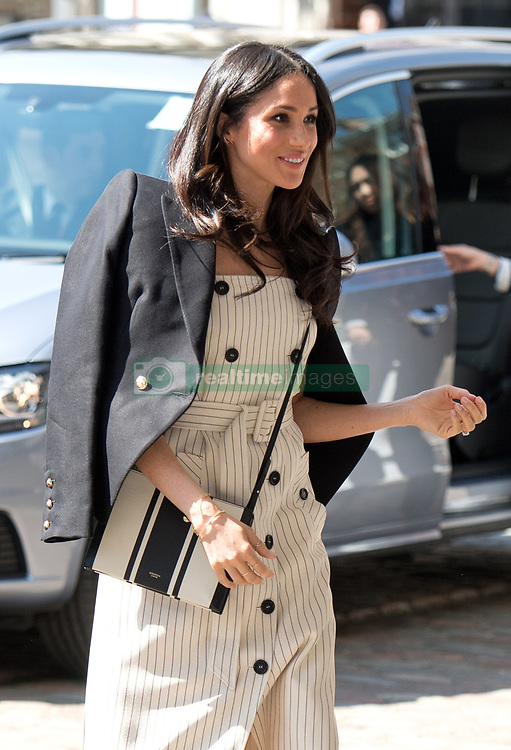 Meghan Markle, wearing a black blazer by Australian designer Camilla and Marc and a striped dress by Altuzarra, attends a reception with delegates from the Commonwealth Youth Forum in London on April 18, 2018