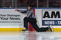 KELOWNA, BC - JANUARY 24: Line official Michael McGowan stretches at centre ice at the Kelowna Rockets against the Seattle Thunderbirds at Prospera Place on January 24, 2020 in Kelowna, Canada. (Photo by Marissa Baecker/Shoot the Breeze)