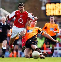 Photo. Daniel Hambury, Digitalsport<br /> Arsenal v Sheffield United. <br /> FA Cup Fifth Round.<br /> 19/2/2005.<br /> Arsenal's Jose Antonio Reyes is stopped by Sheffield United's Phil Jagielka.