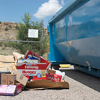 071615      Cayla Nimmo<br /> <br /> Cardboard piles up outside a receptacle at the recycling depot at the Larry Brian Mitchell Recreation Center in Gallup Thursday.