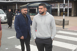 Boxer Amir Khan gives the thumbs up as he arrives back in the UK after his controversial trip to Dubai. The British boxer, 30, was spotted at Manchester Airport in a grey hoodie and black Adidas tracksuit bottoms. Khan, 30, has been embroiled in a very public break-up with his wife Faryal Makhdoom. The boxer, who is worth £23million, initially claimed he and Faryal were getting divorced and accused his American wife of having an affair with heavyweight rival Anthony Joshua, who has denied the claim. 08 Aug 2017 Pictured: Amir Khan. Photo credit: MEGA TheMegaAgency.com +1 888 505 6342