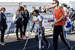 November 13, 2016 - Athens, Greece - A girl with crutches finishes at the 5km race. The 34st Athens Authentic Marathon marks the 120th anniversary of the first contemporary Marathon race in 1896. The event is inspired by the ancient hemerodromos that run from Marathonas to Athens to bring the victorious news of the battle against Persians in 480 BC. The race of 1896 was won by the Greek Spiros Louis. The event is dedicated to Grigoris Lambrakis, a doctor, Balkan Athletic Games champion and pacifist. At the Marathon race more than 18000 athletes competed, making a new record of participants. (Credit Image: © Kostas Pikoulas/Pacific Press via ZUMA Wire)