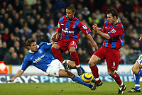 Photo. Chris Ratcliffe<br /> Crystal Palace v Birmingham City. Barclays Premiership. 26/02/2005<br /> MAtthew Upson of Birmingham goes in hard on Wayne Routledge as Dougie Freedman of Palace also watches on.