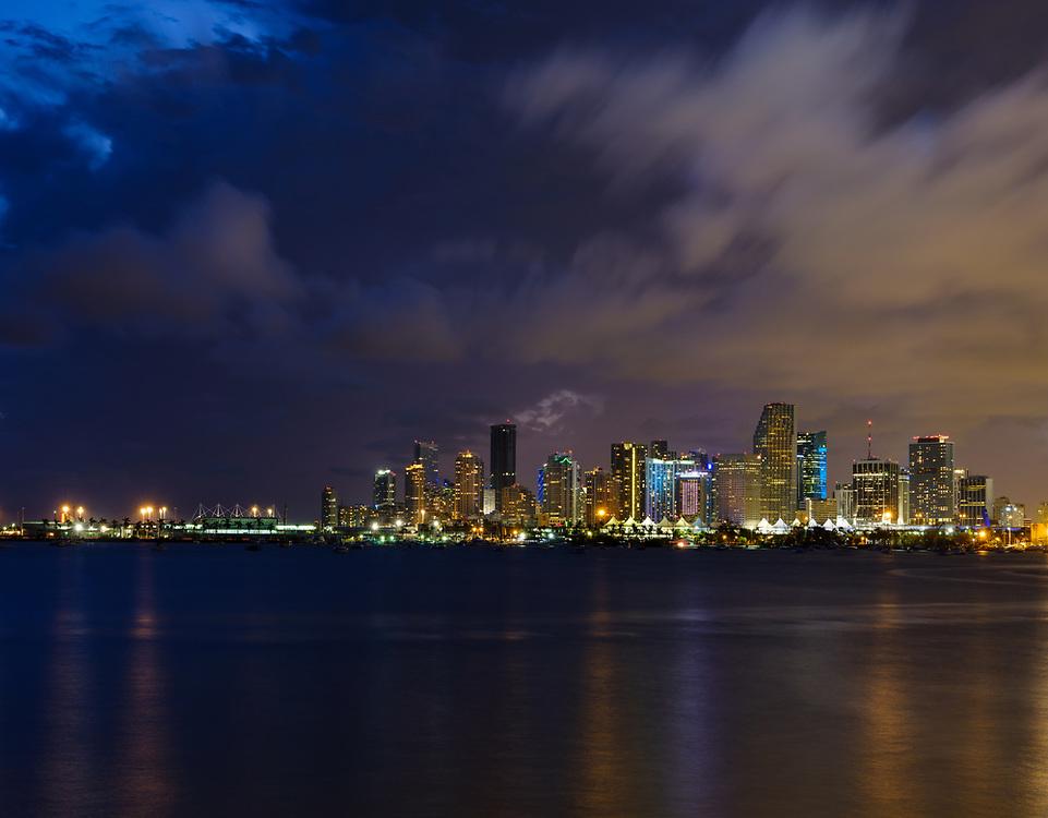MIAMI, FLORIDA - CIRCA SEPTEMBER 2017: View of Downtown Miami, the Miami Seaport and Biscayne Bay at Dusk