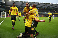 Sebastian Prodl of Watford (c) celebrates after scoring his sides 2nd goal with Troy Deeney, the Watford captain and Adlene Guedioura of Watford.Premier league match, Watford v Everton at Vicarage Road in Watford, London on Saturday 10th December 2016.<br /> pic by John Patrick Fletcher, Andrew Orchard sports photography.
