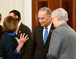 United States House Minority Leader Nancy Pelosi (Democrat of California), left, engages in conversation with US Senate Minority Leader Chuck Schumer (Democrat of New York) and US Senate Majority Leader Mitch McConnell (Republican of Kentucky) prior to the arrival of US President Donald Trump at a reception for US House and US Senate Republican and Democratic leaders in the State Dining Room of the White House in Washington, DC, USA, on Monday, January 23, 2017. Photo by Ron Sachs/CNP/ABACAPRESS.COM