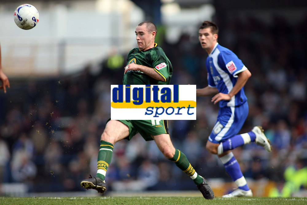 Norwich player Andy Hughes breaks out from defence