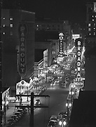 Y-481215-A01. Portland SW Broadway night shots looking north from the Oregonian Building, Broadway T heatre, Orpheum Theatre December 15, 1948
