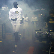 ORLANDO, FL - NOVEMBER 30: Tacko Fall #24 of the UCF Knights runs through smoke onto the court prior to a NCAA basketball game between the Missouri Tigers and the UCF Knights at the CFE Arena on November 30, 2017 in Orlando, Florida. (Photo by Alex Menendez/Getty Images) *** Local Caption *** Tacko Fall