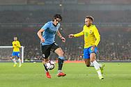 Uruguay forward Edinson Cavani (21) and Brazil forward Neymar Jr (10) during the Friendly International match between Brazil and Uruguay at the Emirates Stadium, London, England on 16 November 2018.