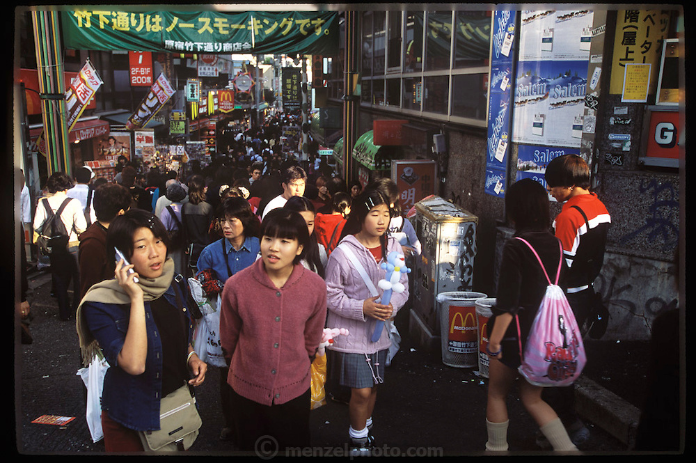 Young Japanese regularly clog the streets of the trendy Harajuku area of Tokyo, near the train station. Tokyo, Japan. (Supporting image from the project Hungry Planet: What the World Eats.)