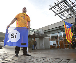 Pictured: Jordie McArthur from Glasgow gets ready for the rally.<br /> <br /> Supporters of Catalonian independence held a rally outside the Scottish Parliament on the day of the controversial elections in the parliament in the Spanish region.<br /> <br /> © Dave Johnston/ EEm