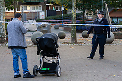 A father is prevented from taking his child to nursery by a police cordon following the murder on October 17th of Ian Tomlin, 46, at the Doddington Estate in Battersea, South London . Battersea, London, October 18 2018.