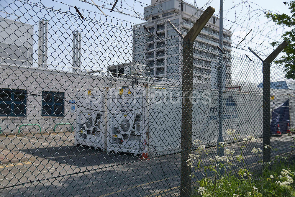 Refrigeration storage containers believed to be for victims of coronavirus at Queen Elizabeth Hospital in Woolwich on 11th April 2020 in London, United Kingdom. As warm weather continues over this long Easter weekend, the government are again urging people to stay at home to safe lives and protect the NHS. Over 73,000 Britains have contracted Coronavirus and UK's hospital death toll has reached 9,875.