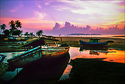 The Malaysian fishing village of Marang wakes up to a new day as dawn breaks over the South China Sea. Few coastal vistas can compare to the view across the Marang River estuary, where fishing boat come and go with the tide. © Steve Raymer, 2002 / ALL RIGHTS RESERVED