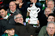 A tin foil FA Cup being held by a fan in the stands before the The FA Cup match between Yeovil Town and Southend United at Huish Park, Yeovil, England on 4 November 2017. Photo by Graham Hunt.