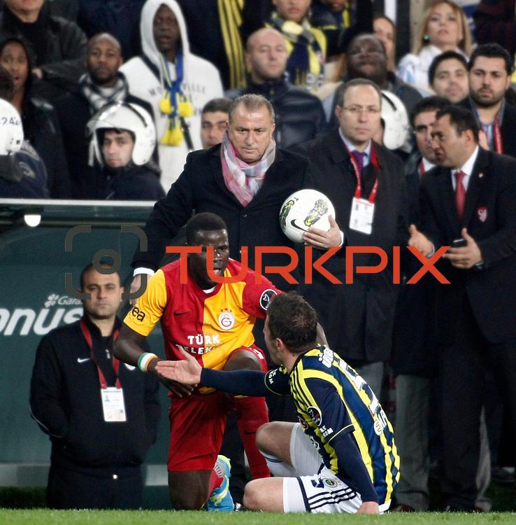 Galatasaray's Emmanuel Eboue (C) during their Turkish superleague soccer derby match Fenerbahce between Galatasaray at Sukru Saracaoglu stadium in Istanbul Turkey on Saturday 17 March 2012. Photo by TURKPIX